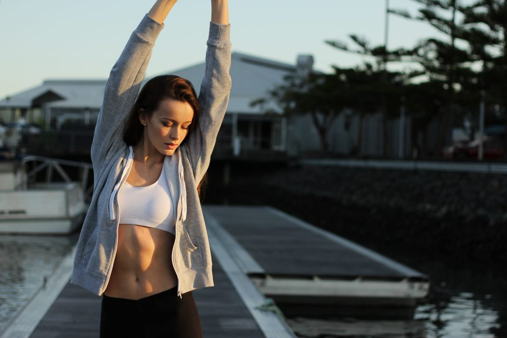 an image of a girl stretching to show a strong core